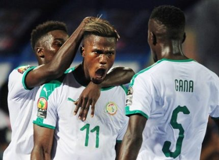 Keita Balde mobbed by team mates after his opener vs Kenya